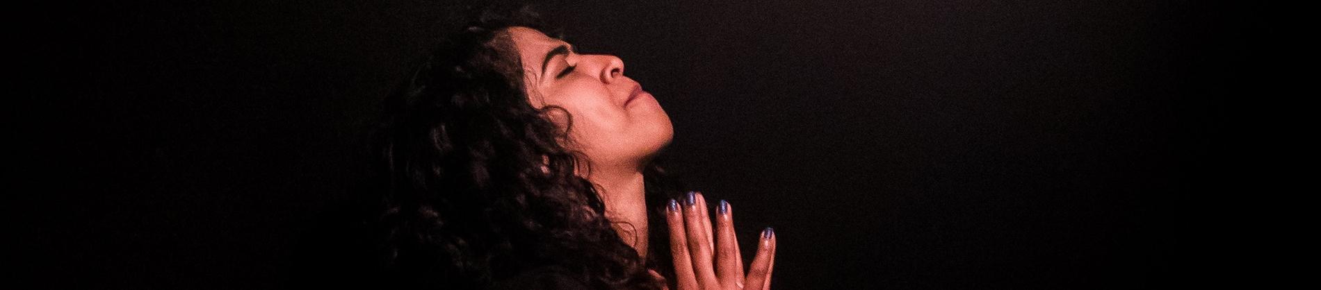 A women deep in prayer