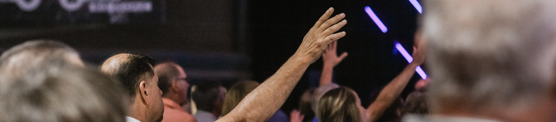 A man worshipping with his hands in the air
