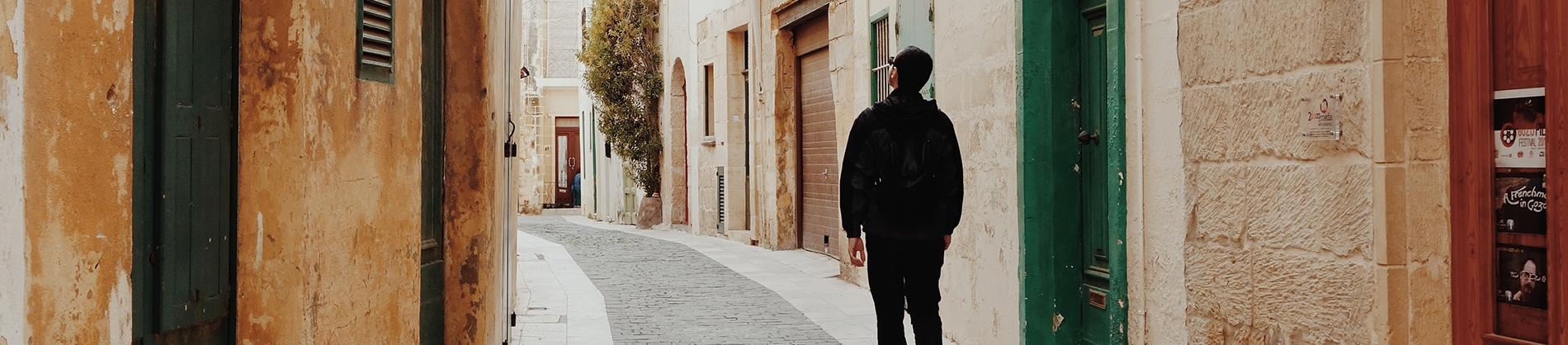 A man walking through a old street