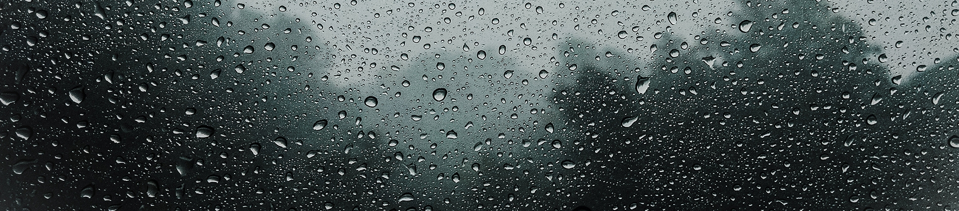 A window with rain drops on it
