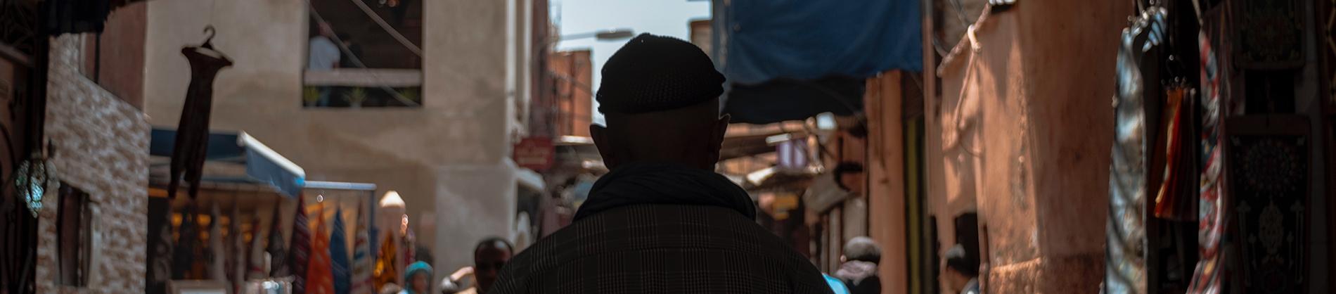 A man walking through a old town
