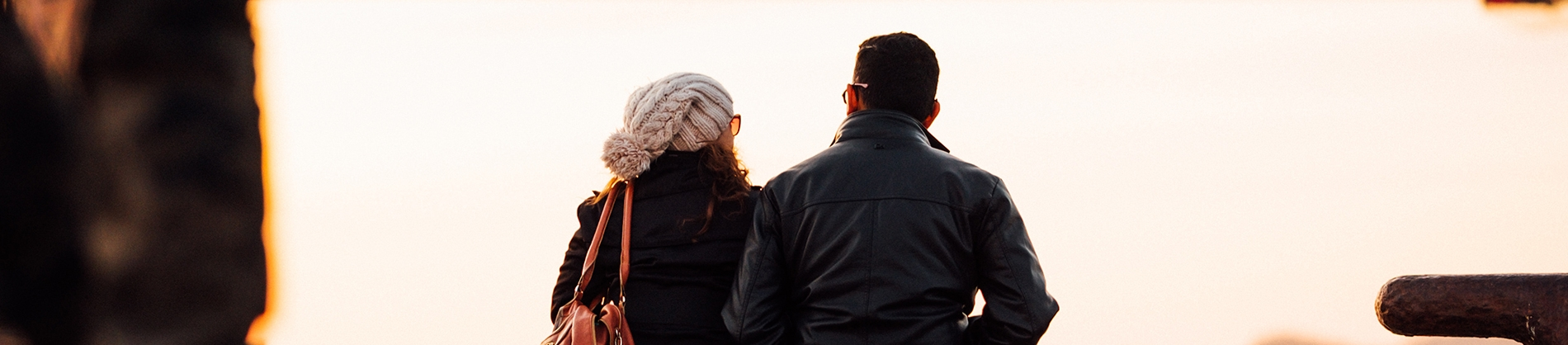 A man and woman sat together looking outwards
