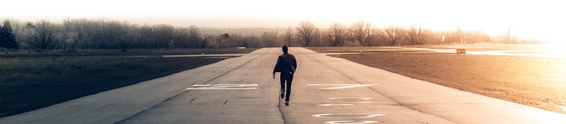 A man running down a runway
