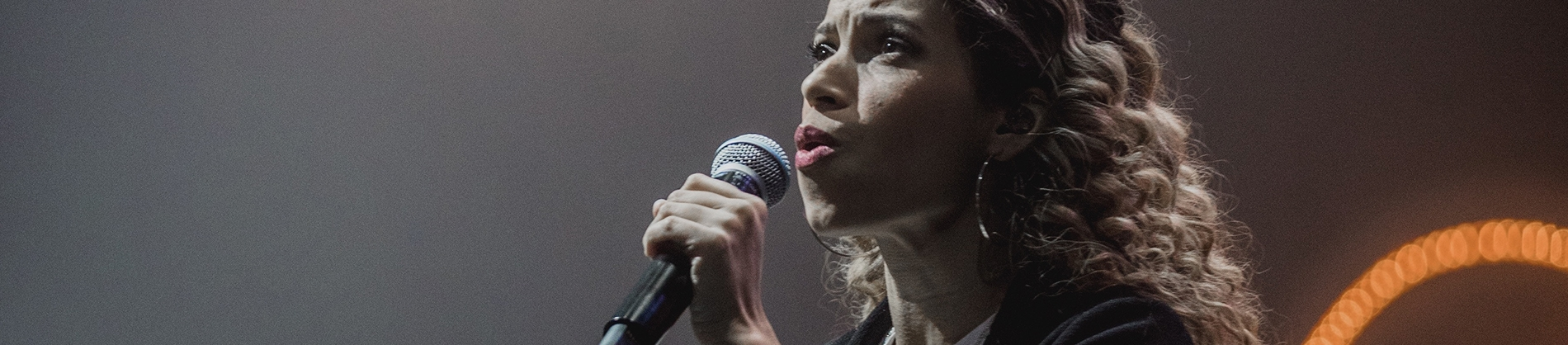 A women singing into a microphone