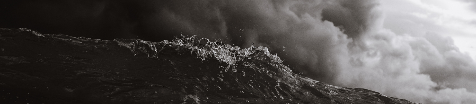 Black and white photo of waves crashing