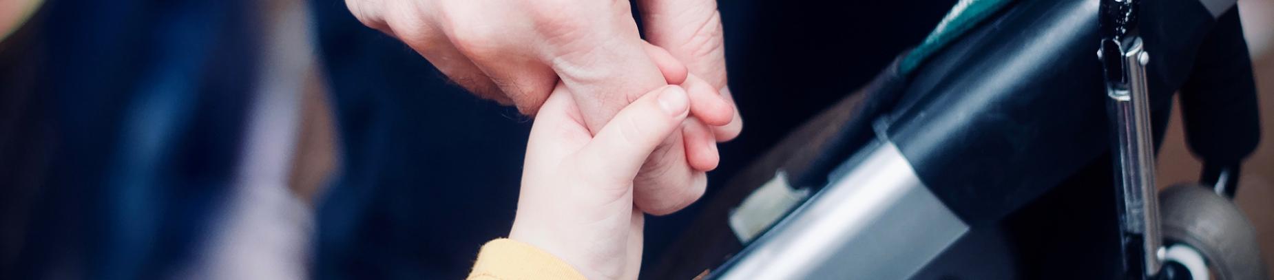 A child holding a parents finger