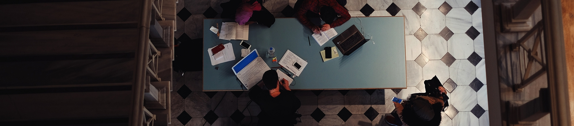 A group of people studying around a table