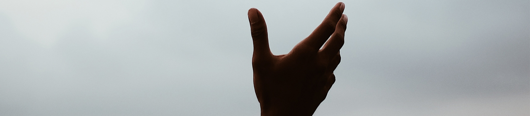 A persons hand open towards the sky