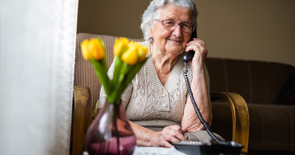 Women smiling while on the phone